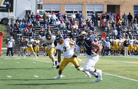 Billy Brown, #81, runs the football down the field to get a first down against West Liberty.
