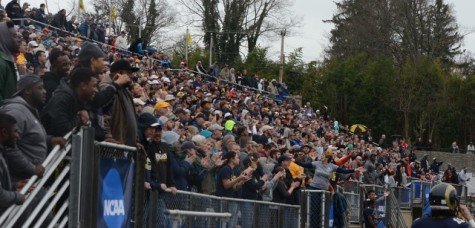 Fans celebrate after the touchdown that won Shepherd Rams the game Saturday.