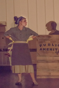 """Hope Wolfford performs as Penelope Pennywise during the musical number """"It's a Privilege to Pee"""" in the play Urinetown."""