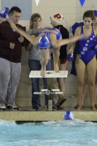 Sydney Izydore, a sophomore nursing major, swam competitively in high school but was forced to stop because of an injury.