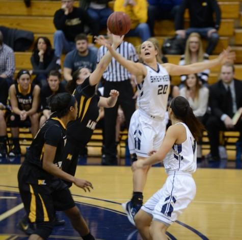 Liz Myers battles Hilltoppers for rebound