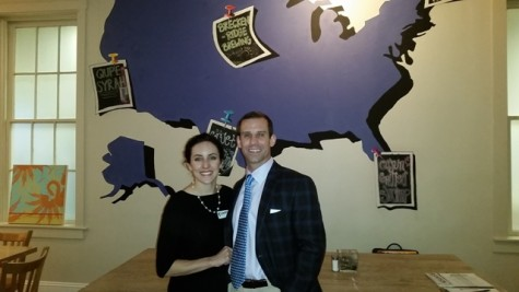 Candidate for West Virginia's 2nd Congressional District Cory Simpson (right) with his wife Dr. Meagan McGinley Simpson (left) standing in front a mural of the United States in at Domestic.