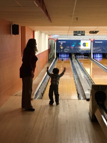 Learning Center Staff Paulette Lashley and child from the center celebrate a really good bowling frame.