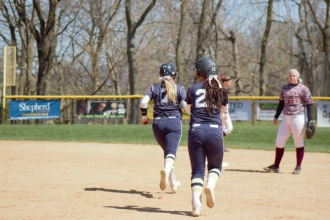 Rachel Taylor rounding the bases after her home run over center field against Fairmont State
