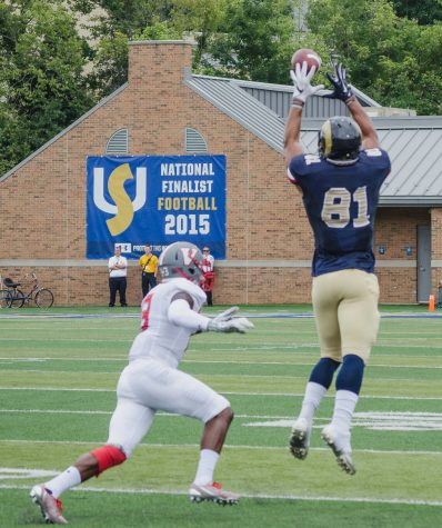 Billy Brown catches another pass gaining more yards for the Rams.