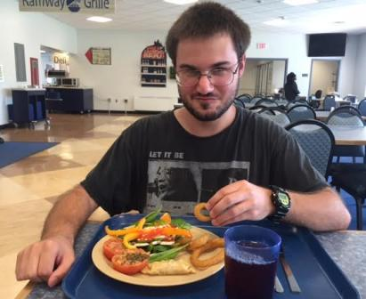 Shepherd University student, Colton Roberts, enjoys a meal in Shepherd's dining hall.