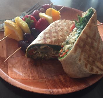 Pesto chicken wrap with a side of fruit from local cafe Mellow Moods.