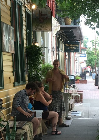 hree Shepherdstown residents enjoy the warm weather after getting coffee from The Lost Dog.