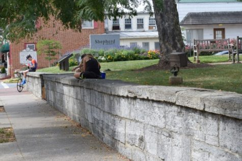 Shepherdstown residents soak up the last few days of summer by relaxing on the wall.