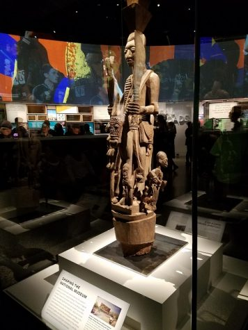 A wooden stature in a traditional African style sits at the center for the first room in the hall dedicated to African American culture.