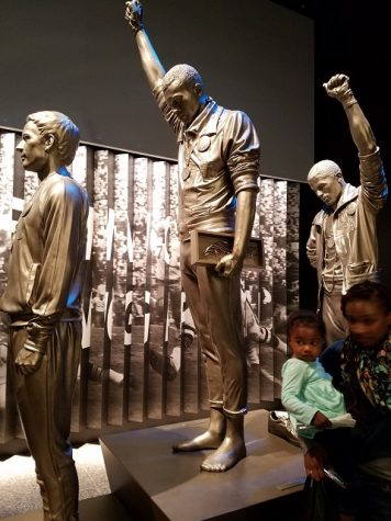 John Carlos and Tommy Smith raise their fists in the black power salute.