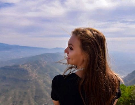 Pandora Affemann posing at the top of Montserrat mountain in Catalonia, Spain.