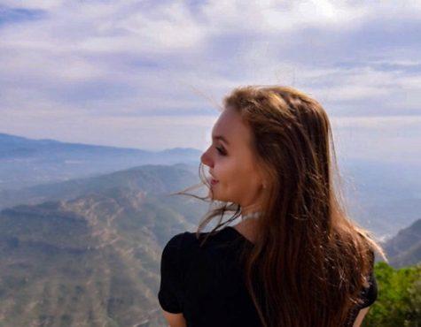 Pandora Affemann posing at the top of Montserrat mountain in Catalonia, Spain.