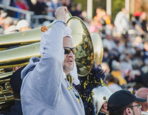 A Ram Fan cheers to an ending score of 27 - 17, with Shepherd winning the game