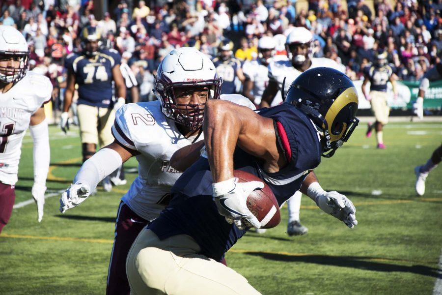 Shepherd receiver tries to shake away Falcons' defender.