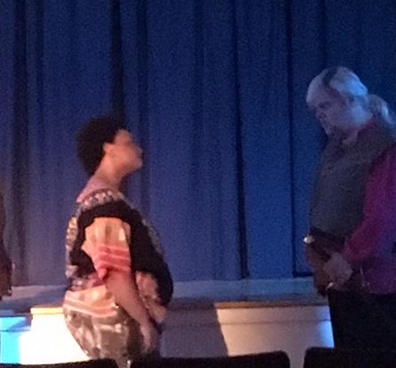 Catherine Ellzey as Othello speaks with Desdemona's father Brabanzio played by Alex Hale.