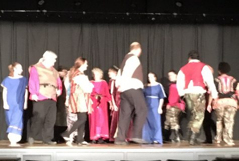 Opening sequence Othello as the charters continue to march.