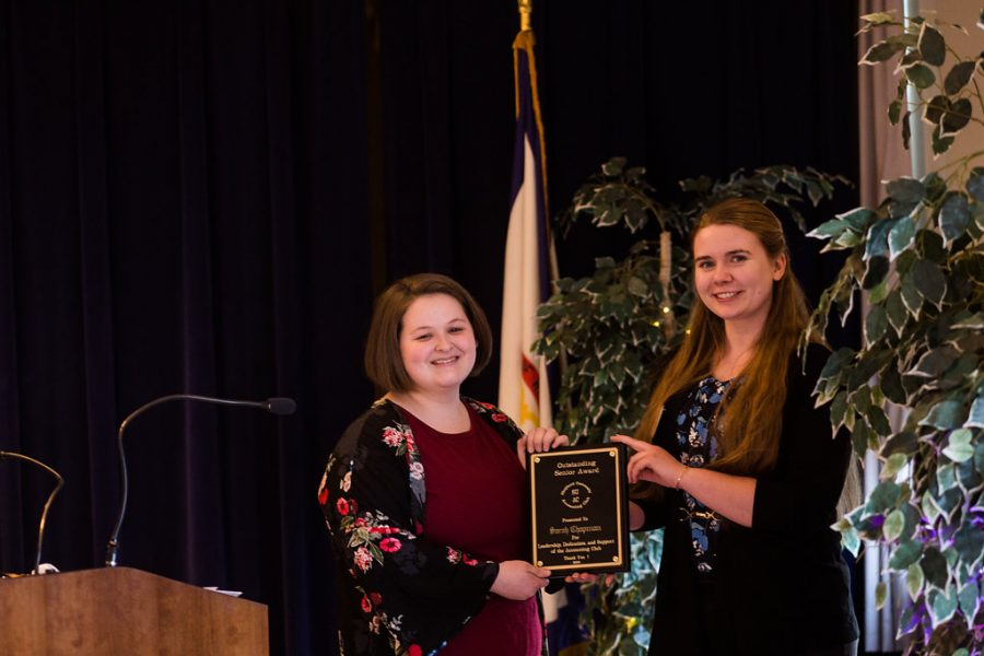 Sarah Chapman being presented the Outstanding Accounting Club Member Award by Polina Gushchina