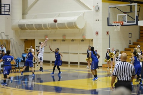 Morgan Arden shooting a 3-pointer to pull the Rams ahead
